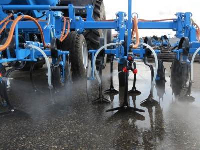 Inter-row cultivators with liquid fertilizer adapter