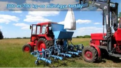 Belarus 82 + Omikron cultivator with fertilizer adapter